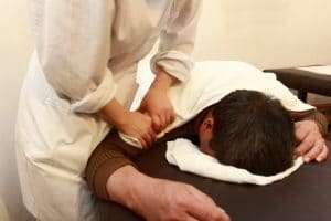 Full Body Chinese Massage to the patient's shoulder